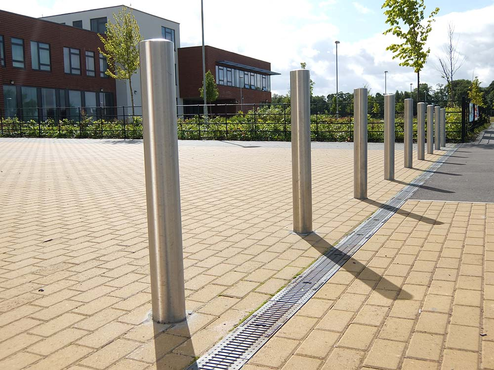 A collection of street bollards in use on a campus supplied by Bollard Street the leading supplier for street bollards.