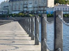 Collection of recycled posts that provide protection from a nearby river. These posts are sustainable and 100% recycled.
