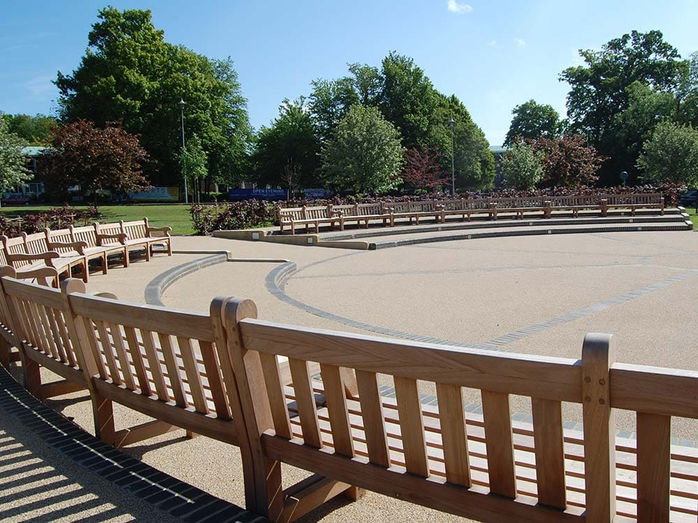 Collection of wooden benches provided as seats or seating solution for a park supplied by Bollard Street.