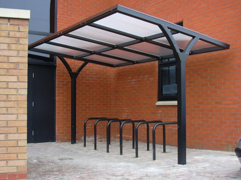 Bicycle, cycle and motor cycle stands in use with a supplied shelter for a client supplied by Bollard Street.